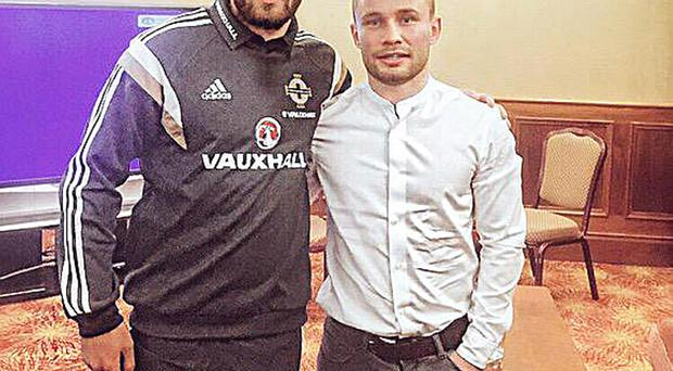 Nice one champ: Northern Ireland's Ryan McLaughlin meets Carl Frampton at the team hotel last night