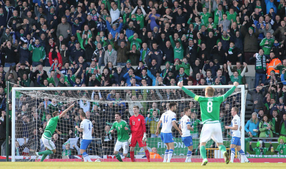 Home is where the heart is: Windsor Park's Kop Stand in full flow during Northern Ireland's win over Finland last Sunday
