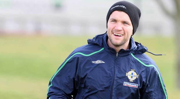 Happy days: Damien Johnson can't wait to get back into a Northern Ireland tracksuit