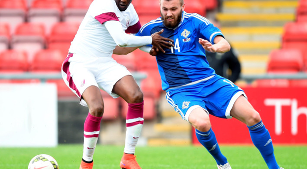Jostle: Stuart Dallas battles for possession with Qatar's Mohammed Musa at Gresty Road, Crewe