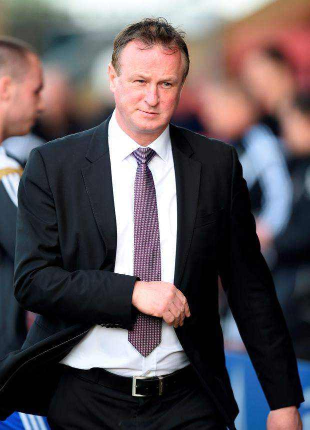 Helping hand: Michael O'Neill may talk to Gordon Strachan