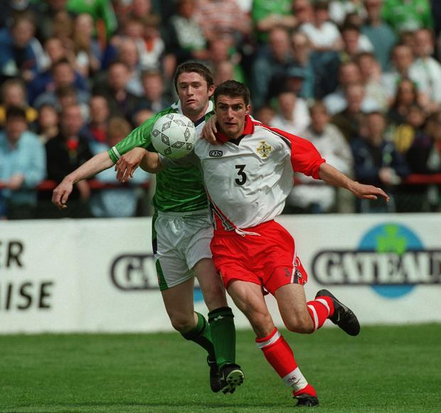 Chase is on: The Republic of Ireland's Robbie Keane puts Aaron Hughes under pressure in 1999