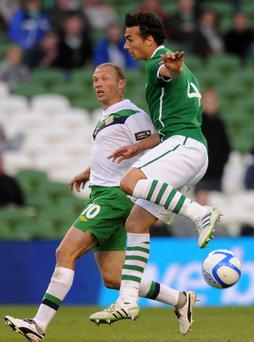 Painful memories: Warren Feeney and Stephen Kelly compete during the Republic's 5-0 Carling Nations Cup win at the Aviva