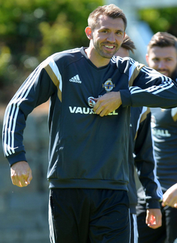 Impressive background: Gareth McAuley believes the new Windsor stands can serve as an inspiration for the game against Romania