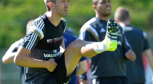 Best foot forward: Gareth McAuley gears up for the clash against Romania in Belfast