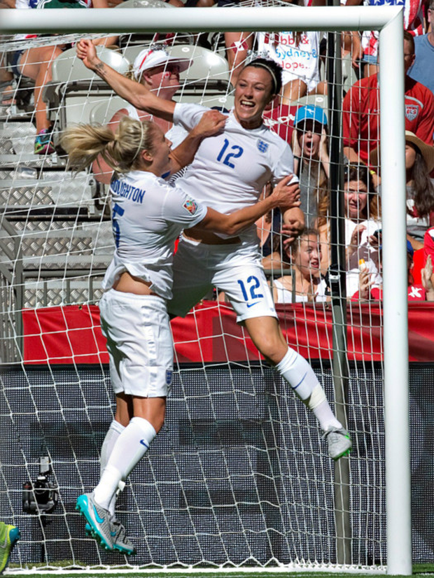 Jumping for joy: Lucy Bronze (right) celebrates her goal against Canada with team-mate Steph Houghton