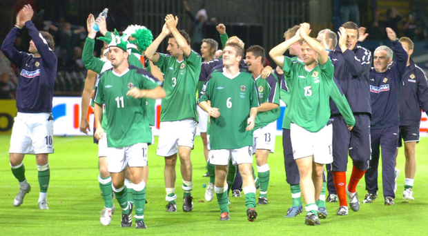 Glory days: Northern Ireland players salute the fans after that famous win over England