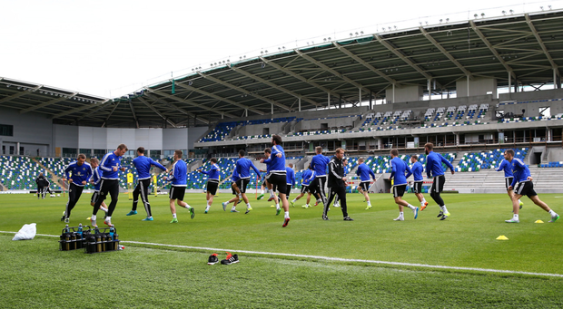 What's in a name: Northern Ireland players train at Windsor Park... in time the stadium will be called something else