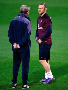 England manager Roy Hodgson and Wayne Rooney