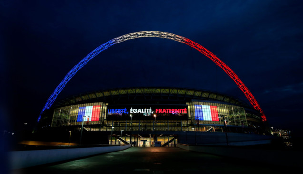 True colours: Wembley will be lit up in the red, white and blue of the French tricolour in tribute to the victims of the Paris terror attacks