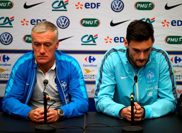 Sombre mood: France manager Didier Deschamps and captain Hugo Lloris face the media at a subdued press conference ahead of their meeting with England at Wembley