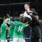 Michael O'Neill celebrates qualification for the Euros with his players