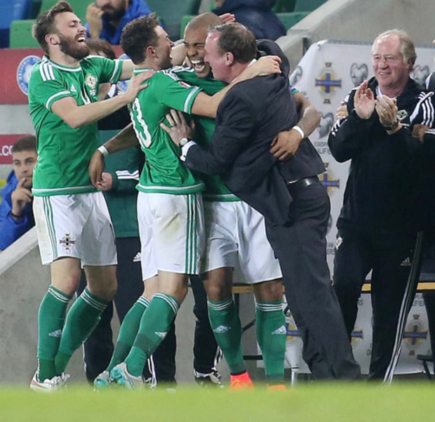 You beauts: Northern Ireland boss Michael O'Neill celebrates qualification for Euro 2016 with his players
