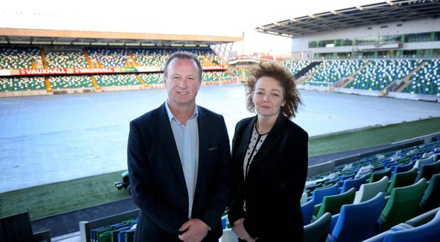 New surroundings: Michael O'Neill welcomes Sinn Fein MLA Caral Ni Chuilin to the new Windsor Park yesterday