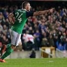 Dream boy: Conor Washington celebrates opening his Northern Ireland goalscoring account at Windsor Park and it was his impressive finish that saw off Slovenia 1-0