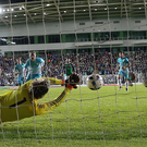 Safe hands: Roy Carroll saves Milivoje Novakovic's penalty kick