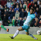 Sharp shooter: Conor Washington keeps his composure to smash home the only goal of the game and help Northern Ireland make it 10 games without defeat