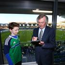 Suite success: Pat Jennings signs an autograph for young fan Kyle Henning in the Pat Jennings suite