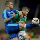 Heat of battle: James McClean gets to grips with Martin Skrtel at the Aviva