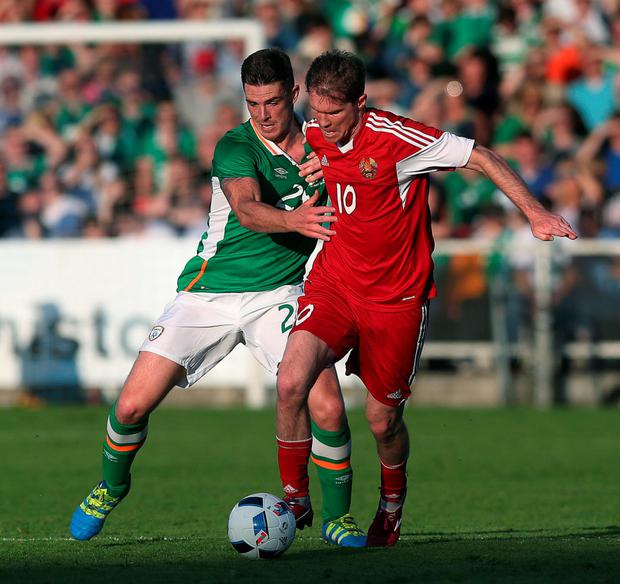 Close quarters: Ciaran Clark battles with Belarus' Alexander Hleb