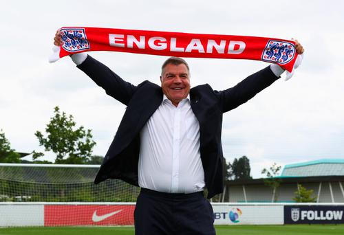 Proud: Sam Allardyce was all smiles when he was officially unveiled as England boss to the media at St George's Park yesterday