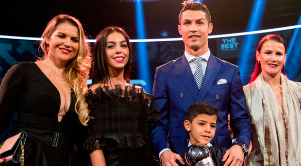 Star quality: Cristiano Ronaldo with his son Cristiano Jnr, girlfriend Georgina Rodriguez (second left) and sisters after being named the world's top player in Zurich last night