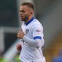 Down to business: Ryan McLaughlin has got over a tough injury spell to become a key part of Oldham's battle to secure safety in League One