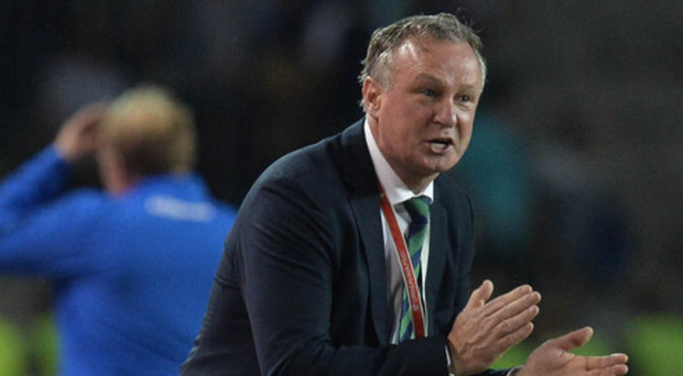 Glory days: Michael O'Neill urges his players on from the sidelines in Baku