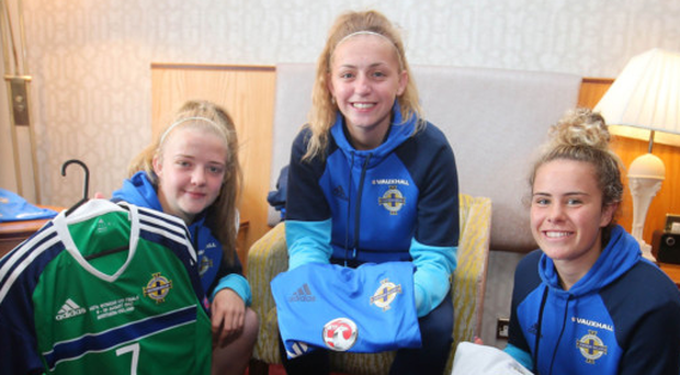 Kitted out: NI captain Emma McMaster, Rebecca Bassett and Brenna McPartlan prepare for the Euros
