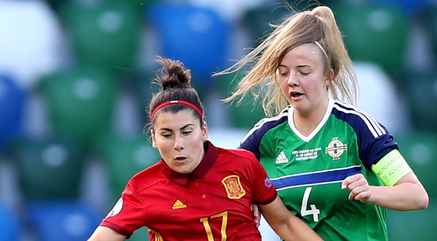 Captain's role: Northern Ireland's Emma McMaster (right) in action during their opening game against Spain.