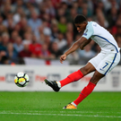 Boy wonder: Marcus Rashford fires the winner for England