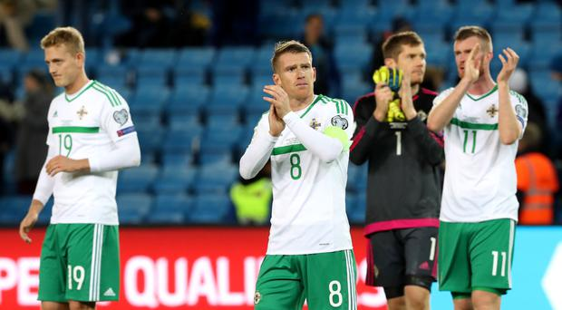 Heads up: Steven Davis leads the applause of the visiting fans after the Norway defeat