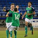 Top marks: Mark Sykes (left) celebrates his goal at Mourneview Park