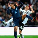 Hands up: Ruben Loftus-Cheek with Germany's Max Meyer