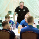 Future stars: Northern Ireland boss Michael O'Neill says a few words as the U21s enjoy a meal in the company of the senior squad at the Culloden Hotel