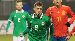 Upcoming star: Crusaders' Gavin Whyte takes on Mikel Merino in Northern Ireland's U21 international against Spain in March.