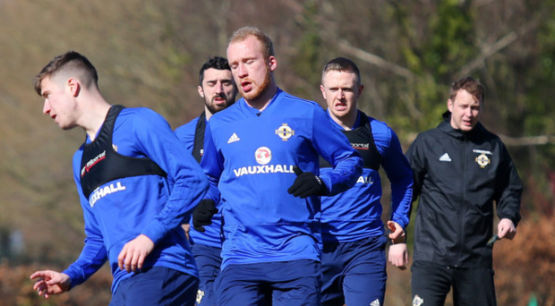 Running start: Liam Boyce is put through his paces at training yesterday, eight months on from being stretchered off
