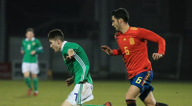 On the run: Northern Ireland's Paul Smyth and Spain's Mikel Merino during last night's game at Shamrock Park