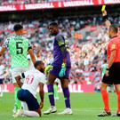 England's Raheem Sterling receives a yellow card for diving