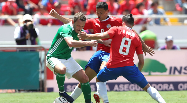 Costa Rica's Daniel Colindres and Bryan Oviedo with Northern Ireland's Lee Hodson