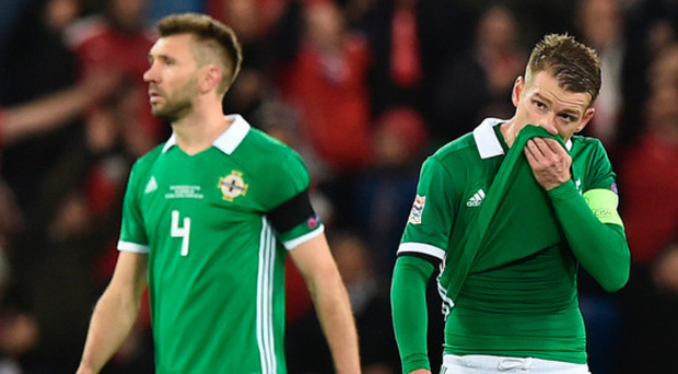 Out of luck: Gareth McAuley and Steven Davis show their dejection after the defeat to Austria