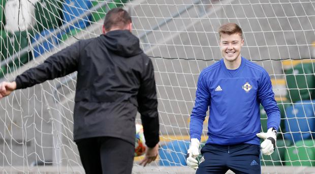 At home: Bailey Peacock-Farrell is put through his paces by Northern Ireland goalkeeping coach Steve Harper