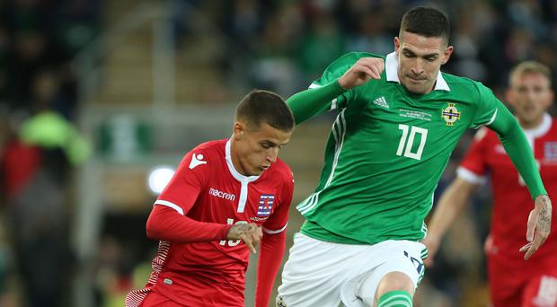 Up close: Northern Ireland's Kyle Lafferty closes down Luxembourg's Vincent Thill on Thursday at Windsor Park