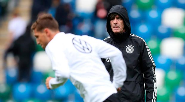 In control: Joachim Low oversees Germany's training session at Windsor Park last night
