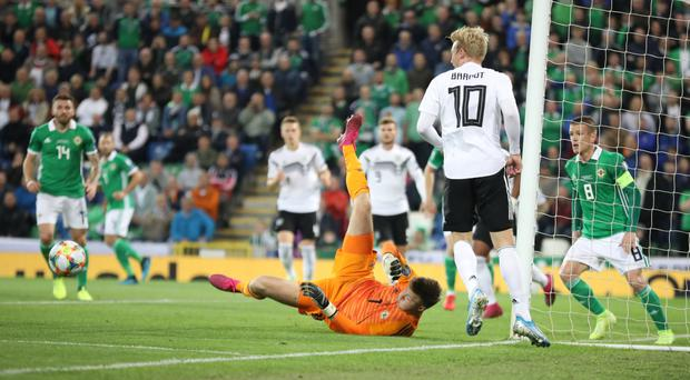 Last line: Northern Ireland's Bailey Peacock-Farrell pulls off another great save to foil Germany