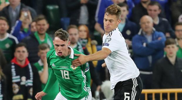 Wing wonder: Northern Ireland's Gavin Whyte takes on Germany's Joshua Kimmich during Monday evening's clash at Windsor Park