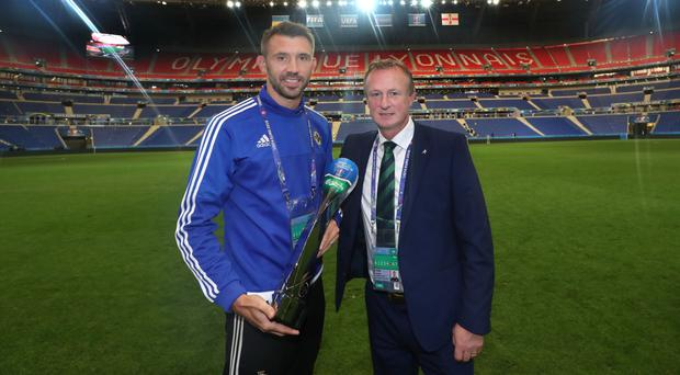 Great times: Gareth McAuley is presented with the man of the match award by Michael O'Neill after beating Ukraine in 2016