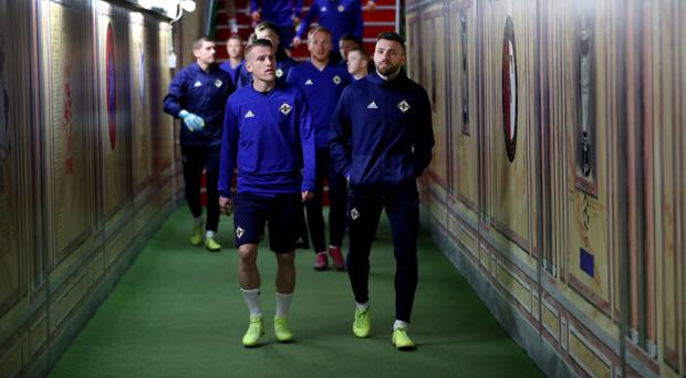 Out in front: Northern Ireland captain Steven Davis (left) and Stuart Dallas lead the squad out at training in Rotterdam last night