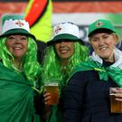 Hair we go: Three Northern Ireland fans shows their colours as part of the Green and White Army last night