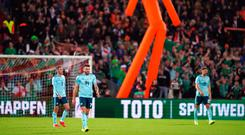 Highs and lows: Northern Ireland players show their pain after the heartache which followed Josh Magennis' opener